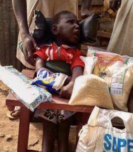 Ogwanga Moses, Age 2, CP Chair, Asuret Village, Soroti Town, Soroti District, Uganda, Cerebral Palsy