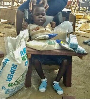Okello Cornelius, Age 2, CP Chair, Kalaki Village, Kalaki Town, Soroti District, Uganda, Cerebral Palsy