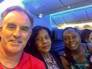 Tim Gillen (Founder), Celia Pompey and Dr. Teina Daley (occupational therapist) seated on the plane to Uganda (10/21/19)