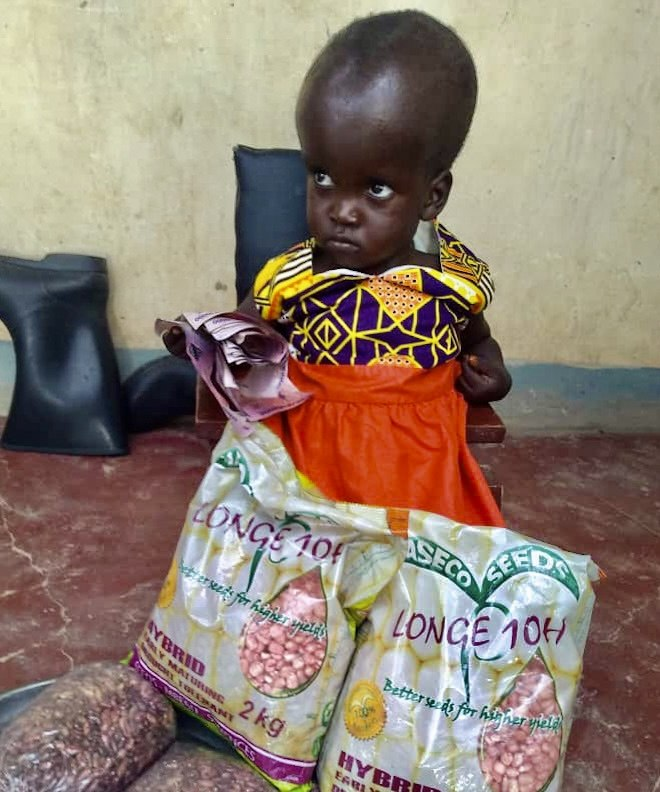 Ayumo Janet with seeds for farming