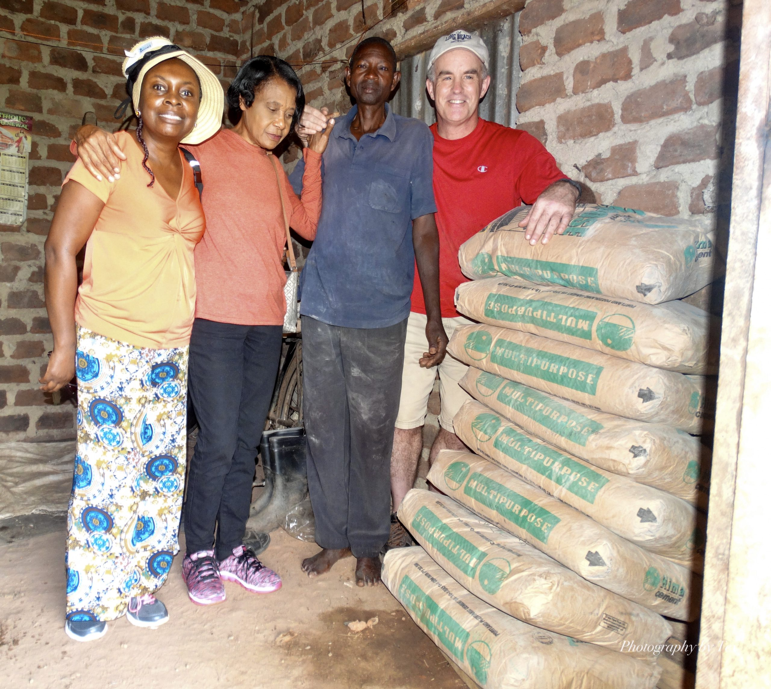 Teina, Celia, Paul Kayonga and Tim dropped off cement for the floors of the Kayonga's home