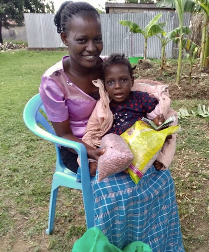 Alobe Ruth Mercy and Her Mum with Seeds to Plant, Nakatunya Village, Soroti District, Farming