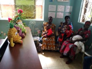 In the lobby at Whispers Childrens Hospital. Left to right: Ngobi Shafik being carried by his mother Jessica Nampina; Mukisa Phillip Jr. being carried by Swaibu's mother Nakagolo Joyce; Wadada Fahad being carried by his mother Babirye Ahiya.