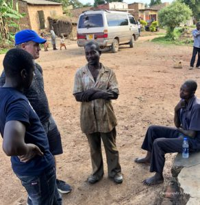 Paul Collins, Tim, Shop Caretaker, and Paul Kayonga negotiating the shop rental cost