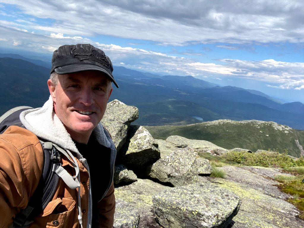 Tim Coming Down Algonquin Peak with Wright Peak Behind