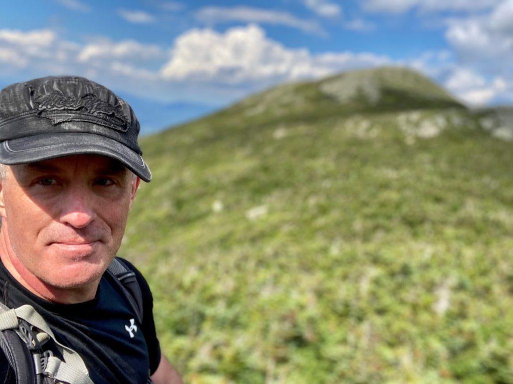 Tim with Iroquois Peak Behind