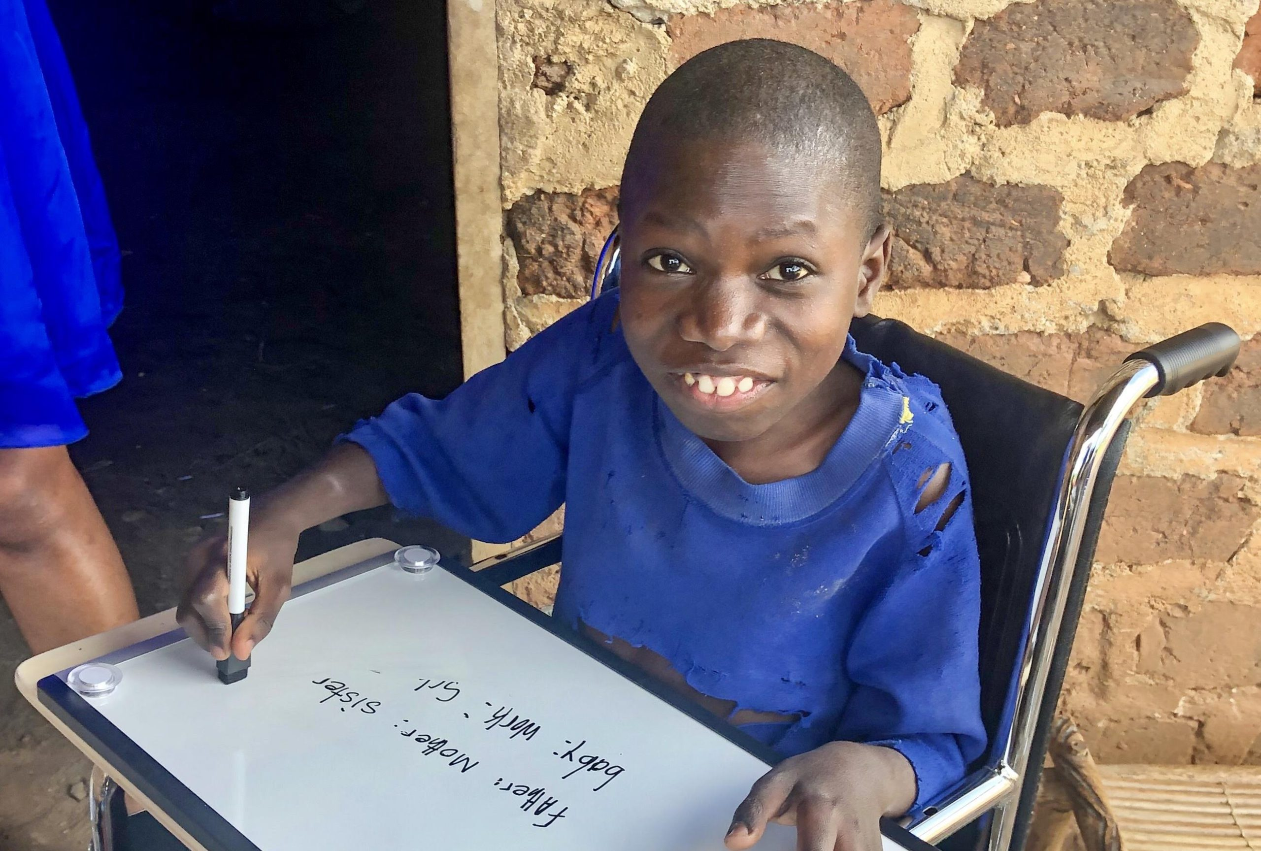 Julius is so excited about his new wheelchair-fitted activity board!