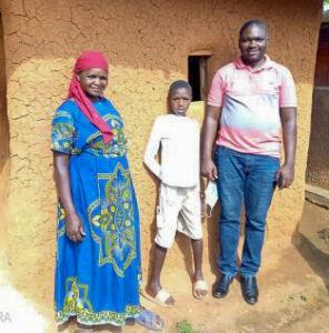Jeremiah Musau (age 11) with his mum and Tony